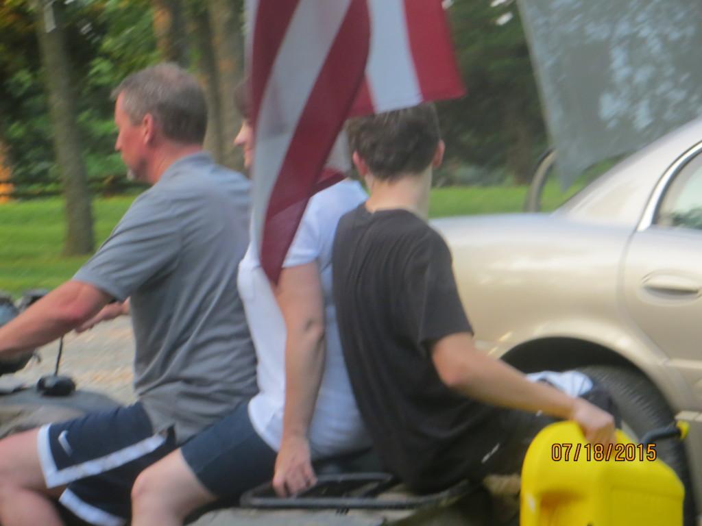 Doug, Kathy an Josh on the 4-wheeler, + flag